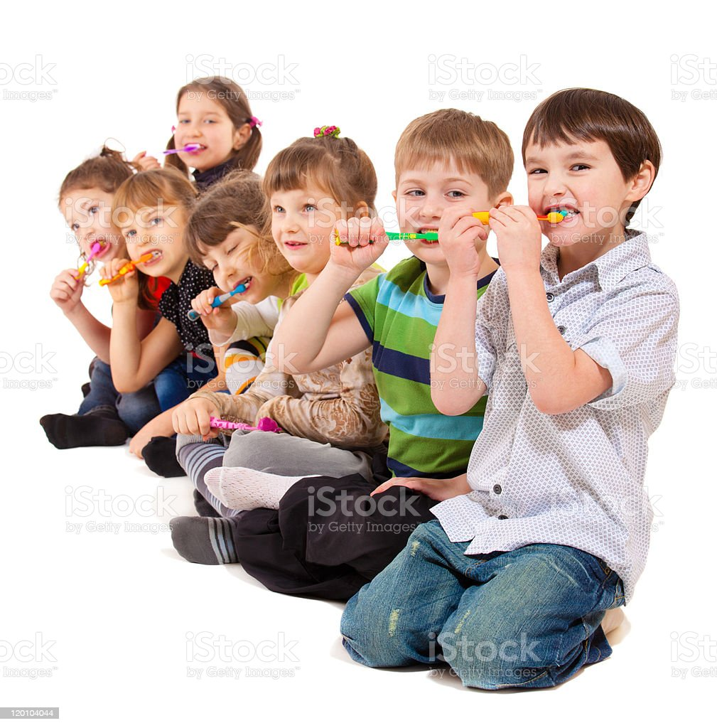 Kids group cleaning teeth stock photo