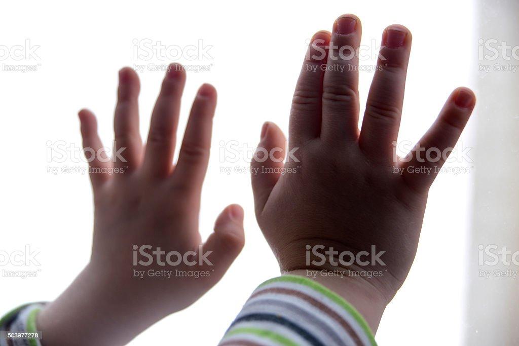 Kid's Hands On Window stock photo