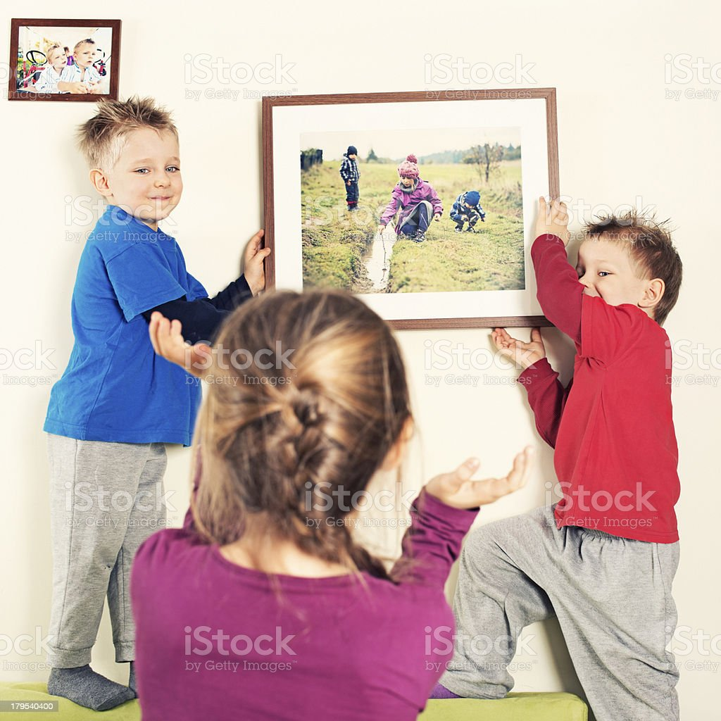 Kids hanging a photo royalty-free stock photo