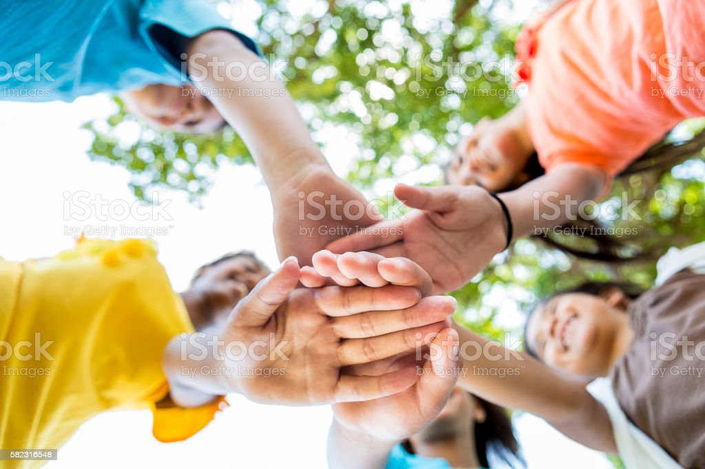 Kids have hands together in circle stock photo