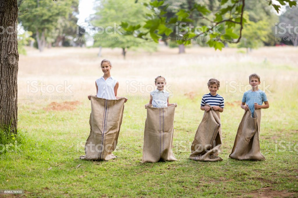 Kids having a sack race in park royalty-free stock photo