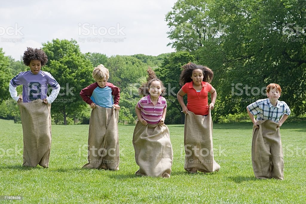 Kids having a sack race stock photo
