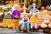 Kids having fun at pumpkin patch at  harvest festival celebration