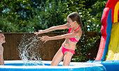 Kids Having Fun In Pool