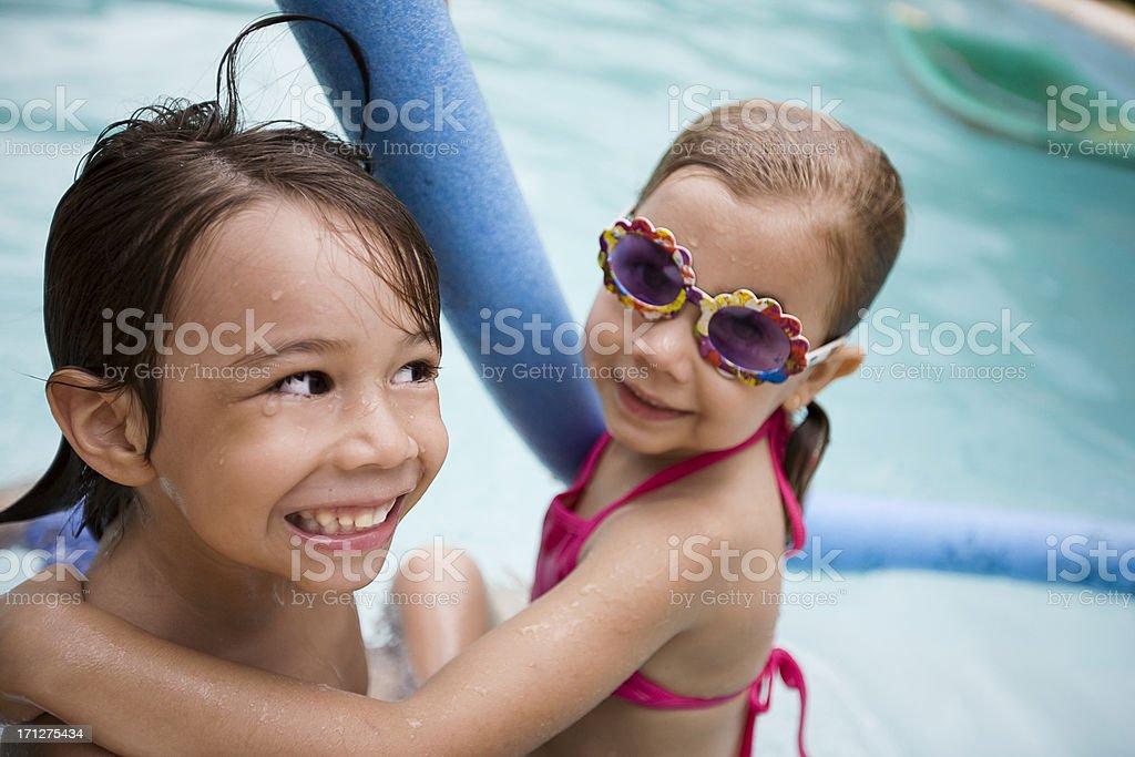 Kids having fun in Swimming Pool royalty-free stock photo