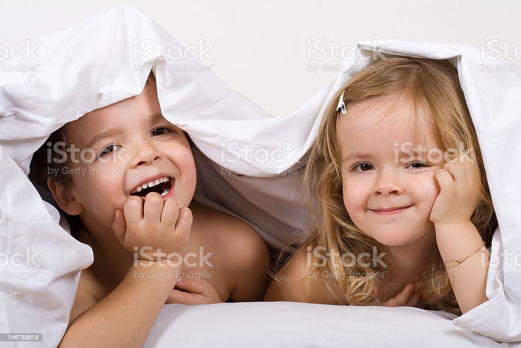 Kids having fun in the bed royalty-free stock photo