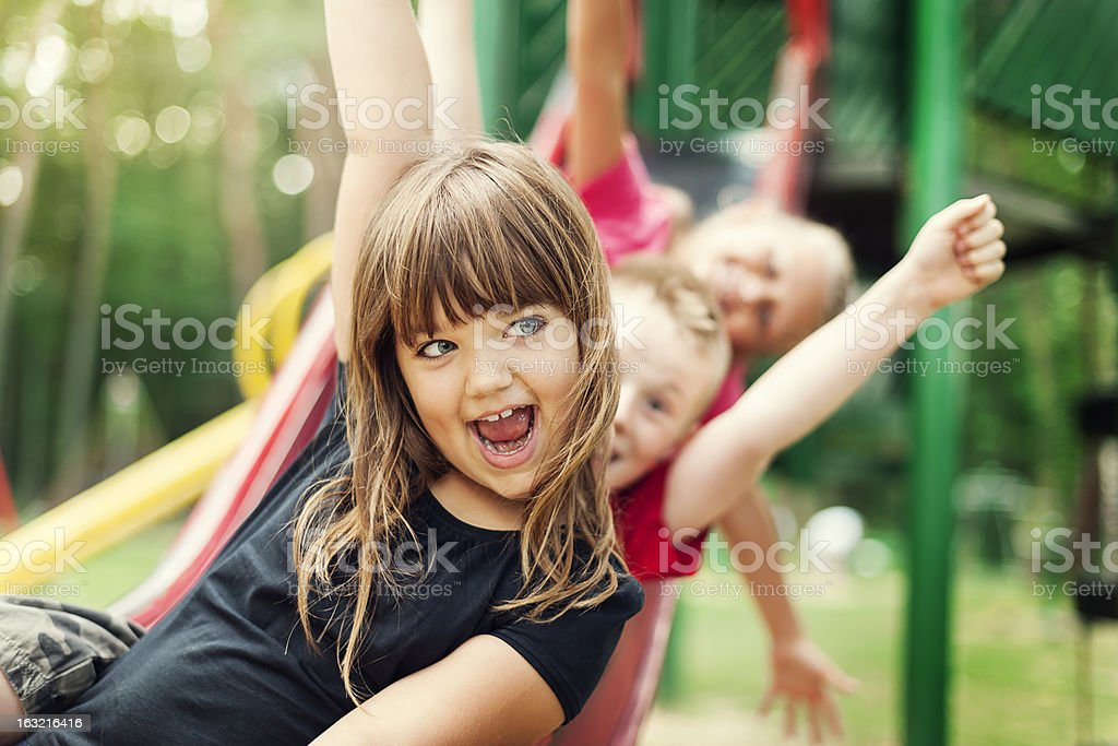 Kids having fun on slide stock photo