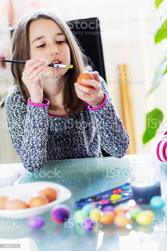 Kids having fun painting easter eggs stock photo