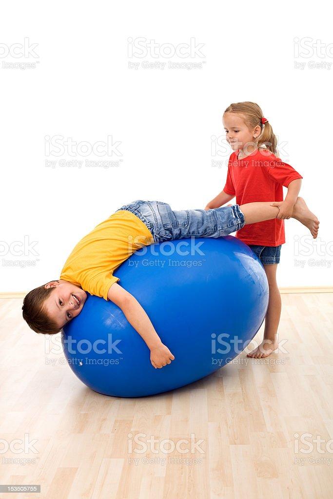 Kids having fun playing with a large rubber ball stock photo