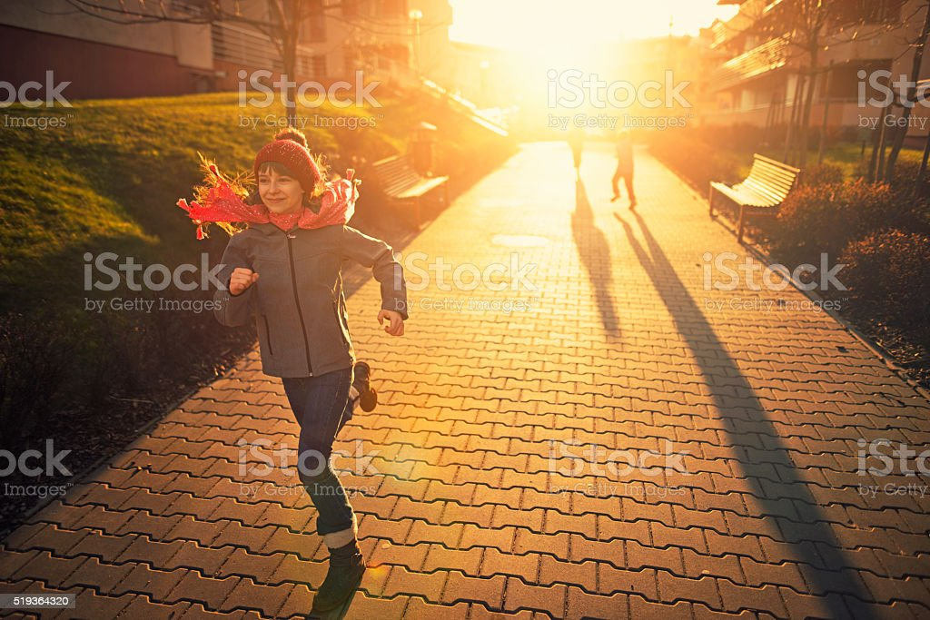 Kids having fun runnin on sunset stock photo