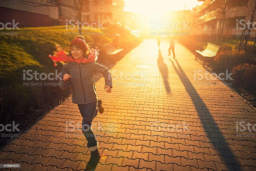 Kids having fun runnin on sunset stock photo