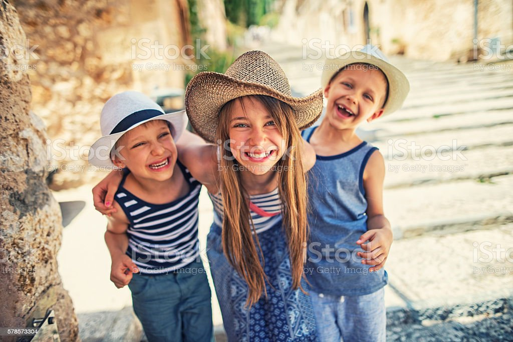 Kids having fun visiting the beautiful Majorcan town of Pollenca stock photo