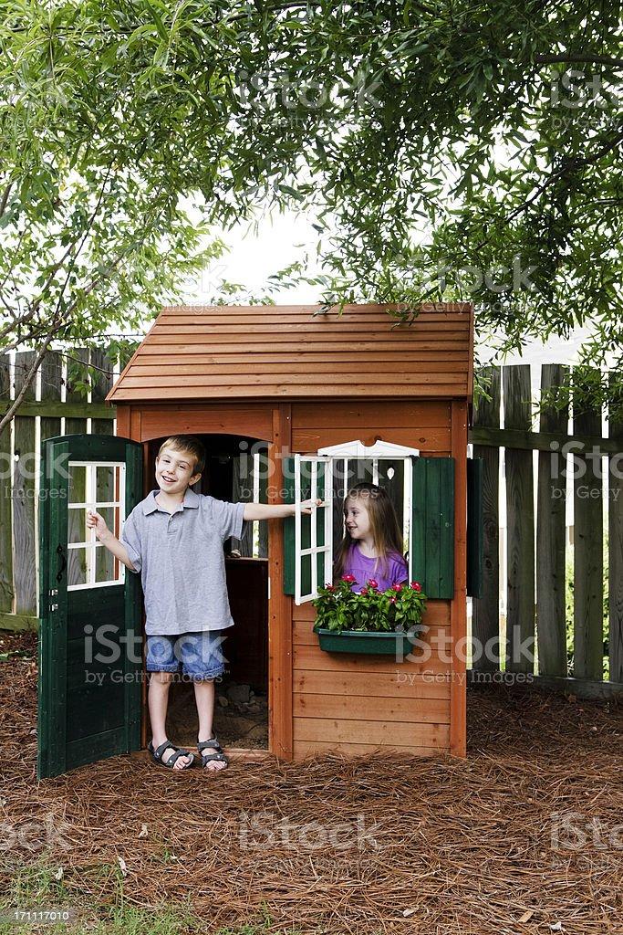 Kids Having Fun with Playhouse stock photo