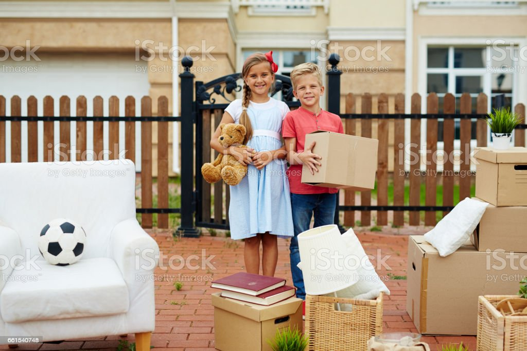 Kids Helping to Move Cardboard Boxes stock photo