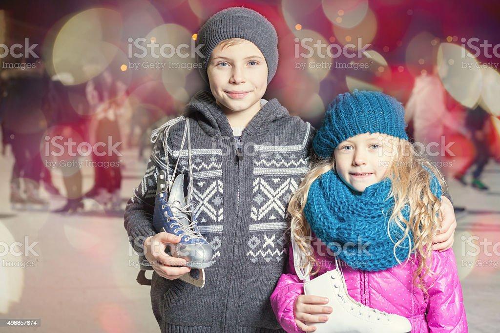 Kids holding ice skates shoes stock photo