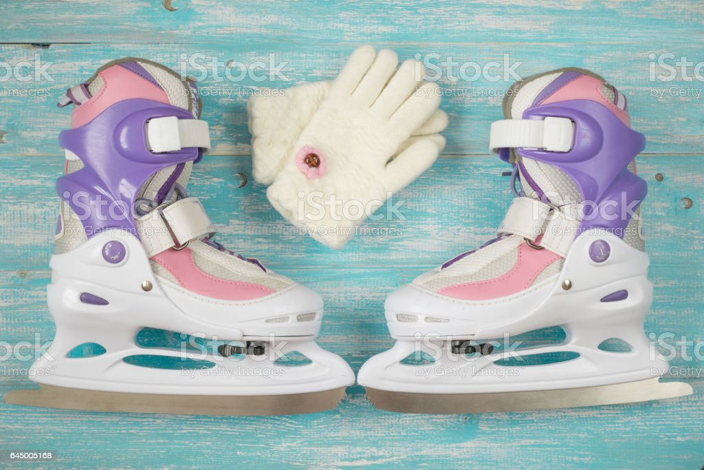 Kids ice skates with adjustable size on the wooden floor. stock photo
