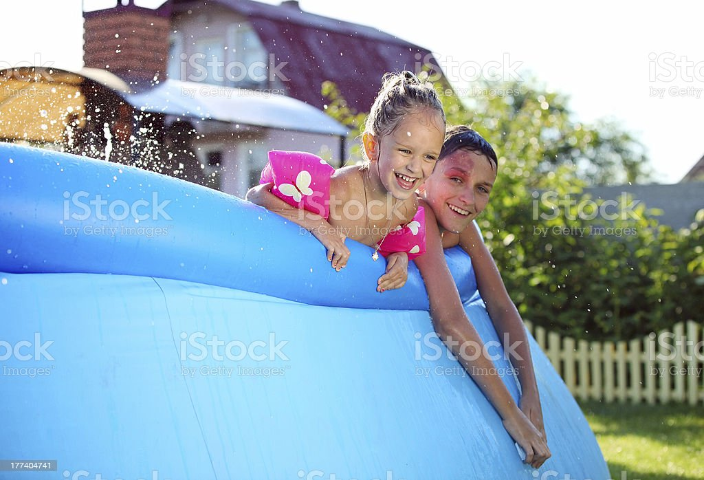 Kids in a inflatable swimming pool stock photo