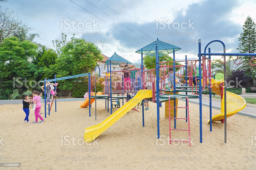 Kids in a playground stock photo