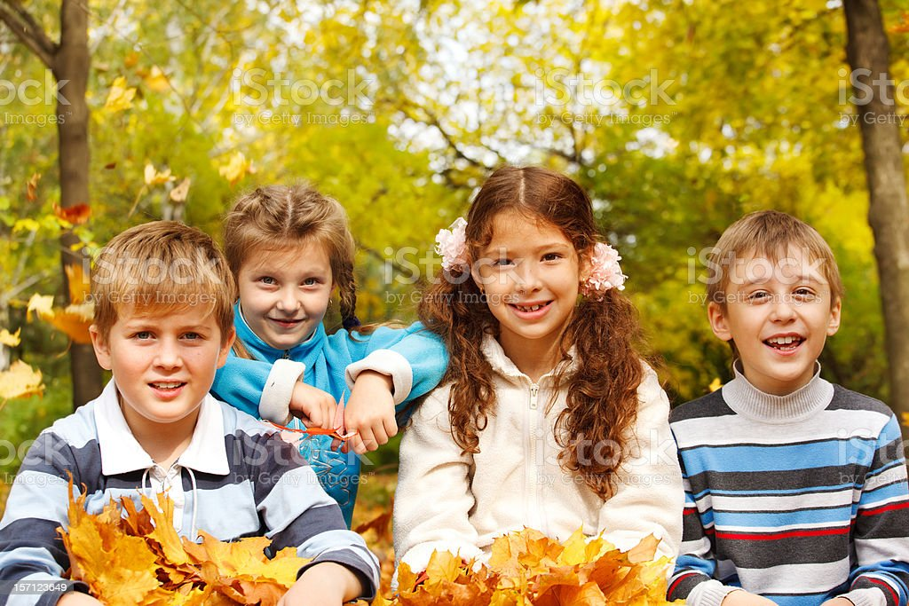 Kids in autumnal park royalty-free stock photo