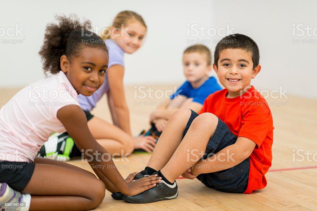 Kids in gym class stock photo