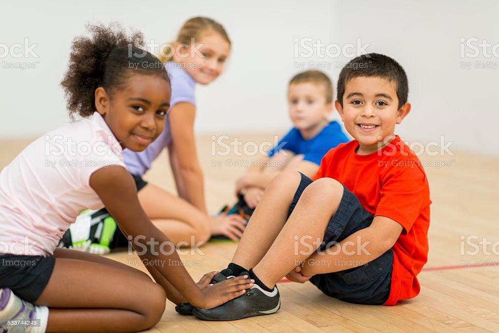 Kids in gym class stock photo