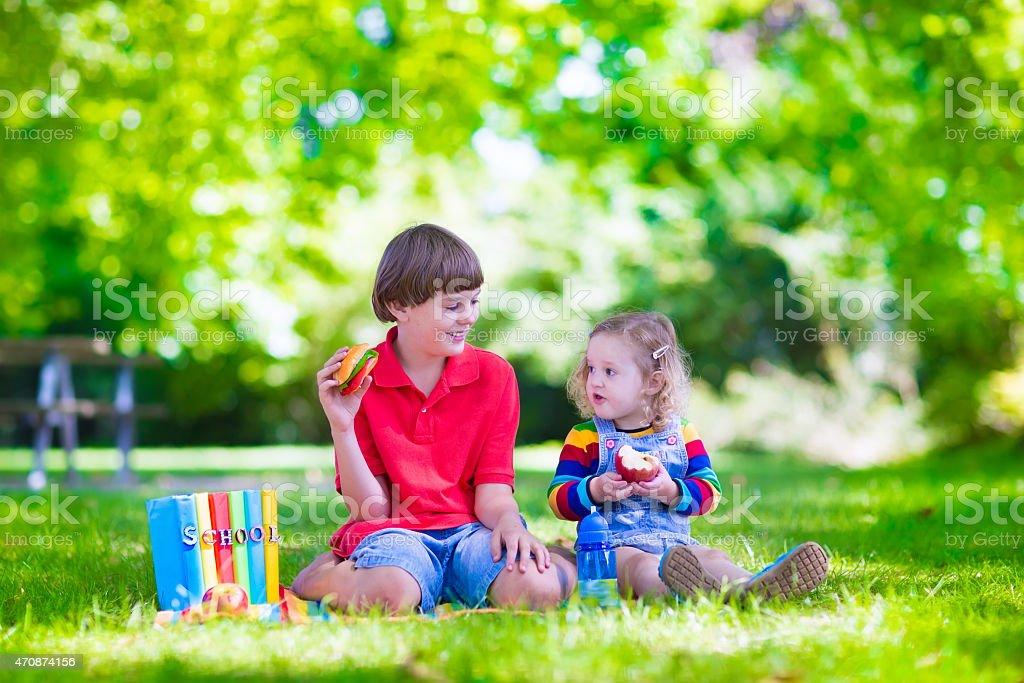 Kids in school yard stock photo