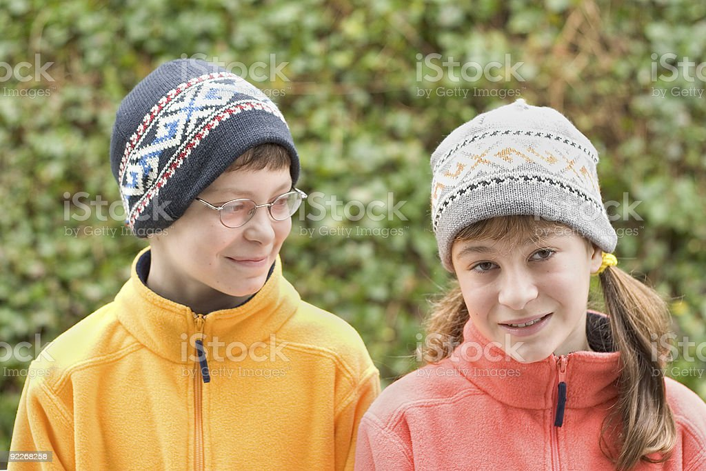 Kids in Ski Hats and Fuzzy Pullovers royalty-free stock photo