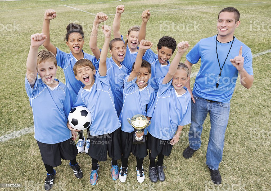 Kids in soccer uniforms celebrating victory royalty-free stock photo