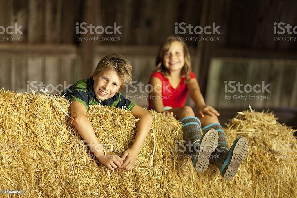 kids in straw barn royalty-free stock photo