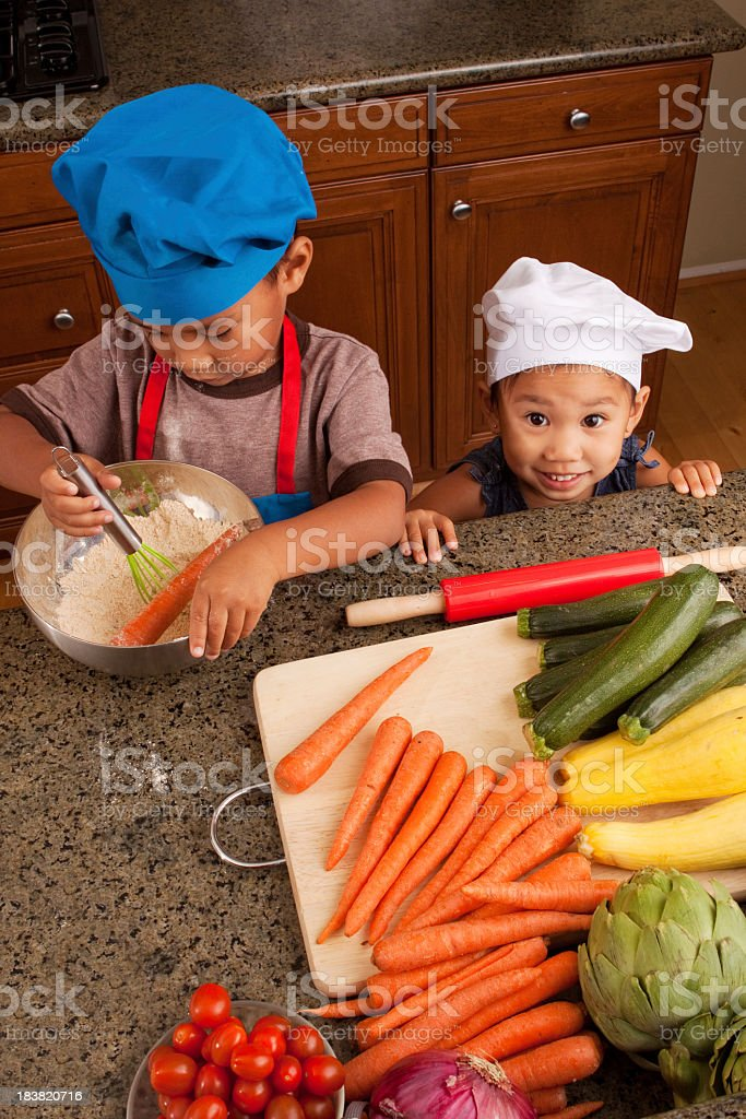 Kids in the kitchen stock photo