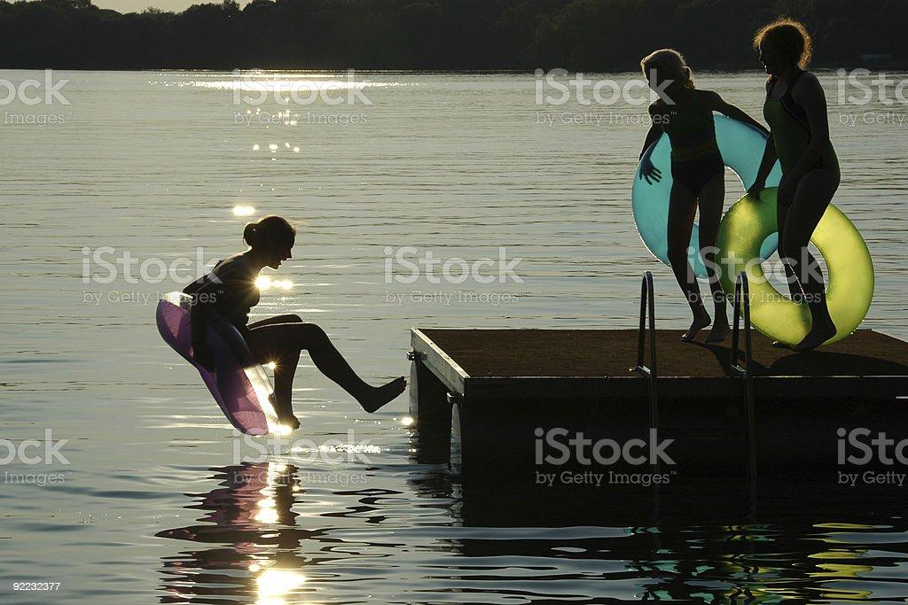 Kids Jumping off Swimraft royalty-free stock photo