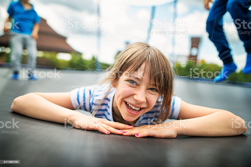 Kids jumping on trampoline stock photo
