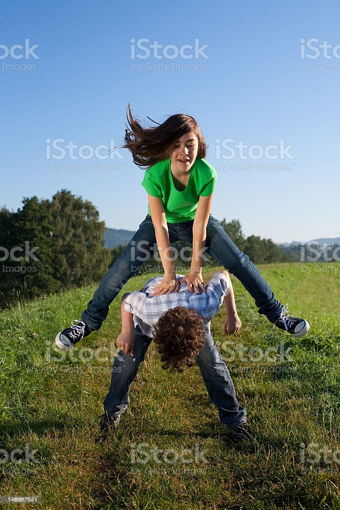 Kids jumping outdoor against blue sky royalty-free stock photo