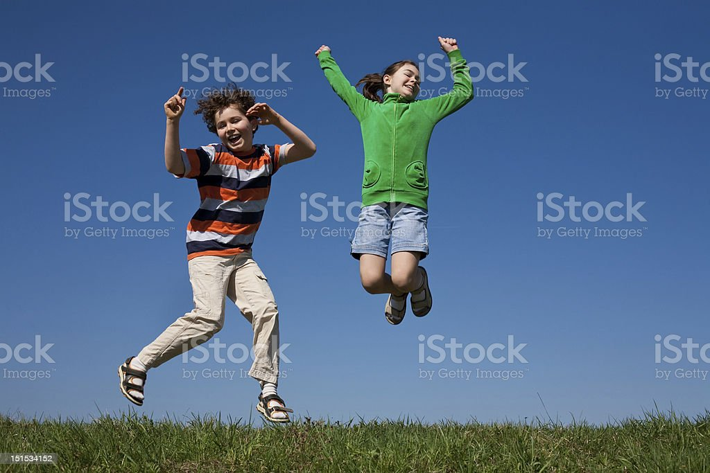 Kids jumping outdoor royalty-free stock photo