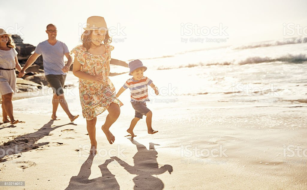Kids just love a beach day! stock photo