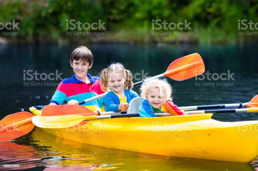 Kids kayaking on a river stock photo