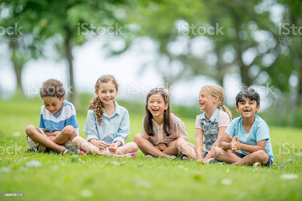 Kids Laughing Outside at the Park stock photo