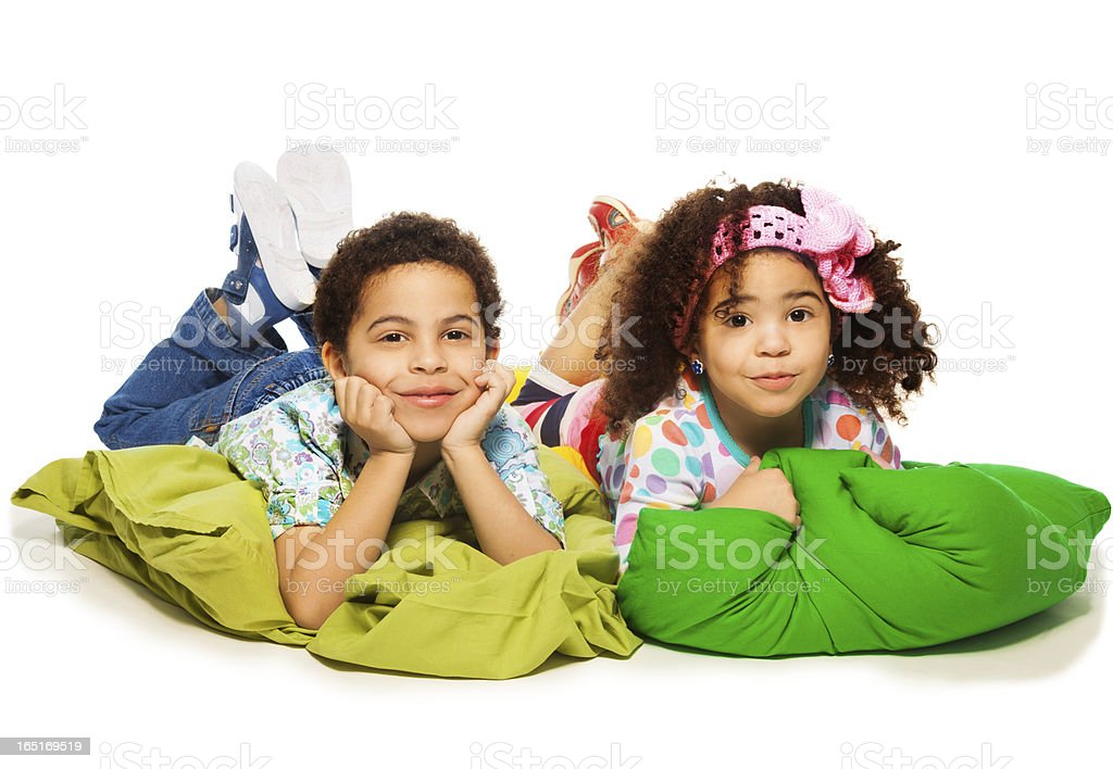 Kids laying on pillows royalty-free stock photo