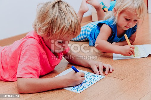 Child learning how to write numbers