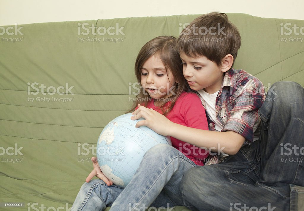 Kids looking at globe royalty-free stock photo