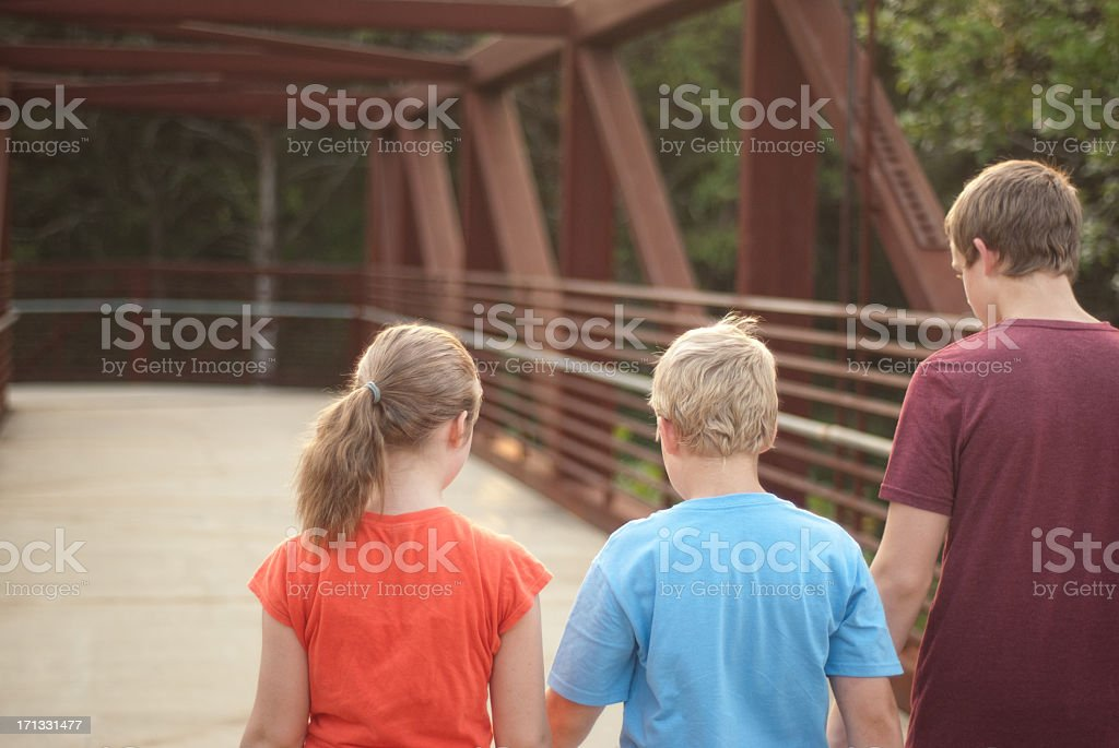 Kids Looking Down From Bridge royalty-free stock photo