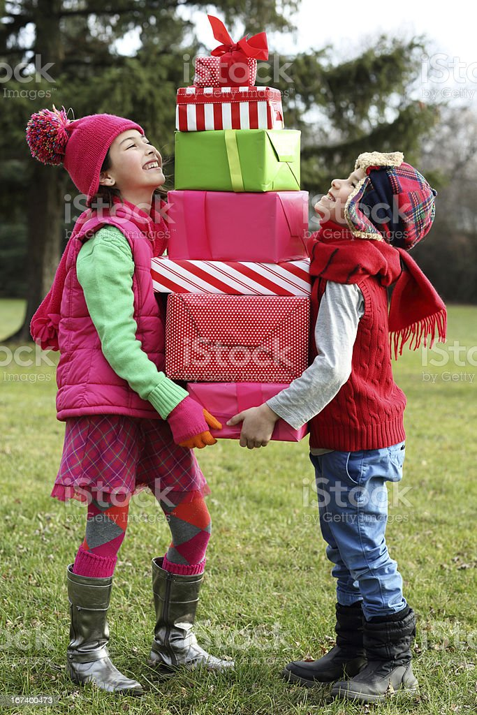 Kids looking on a little gift royalty-free stock photo