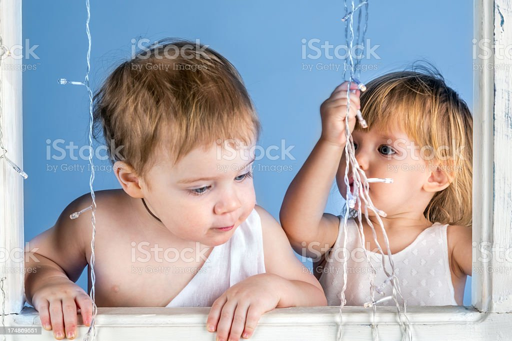 Kids looking out window royalty-free stock photo