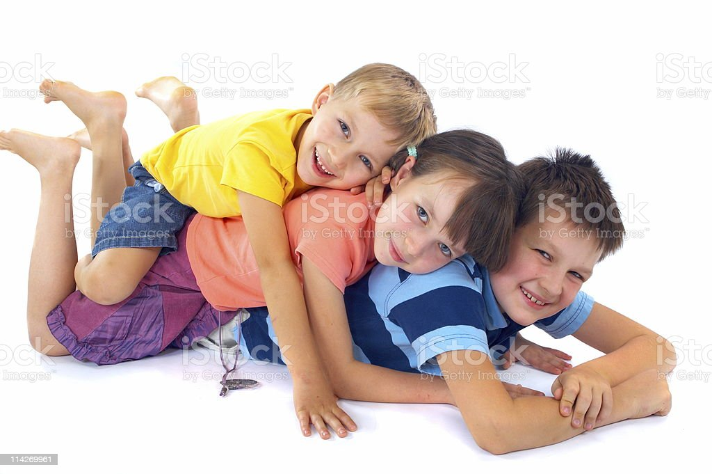 Kids lying on each other royalty-free stock photo