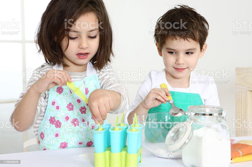 Kids making Ice-cream royalty-free stock photo