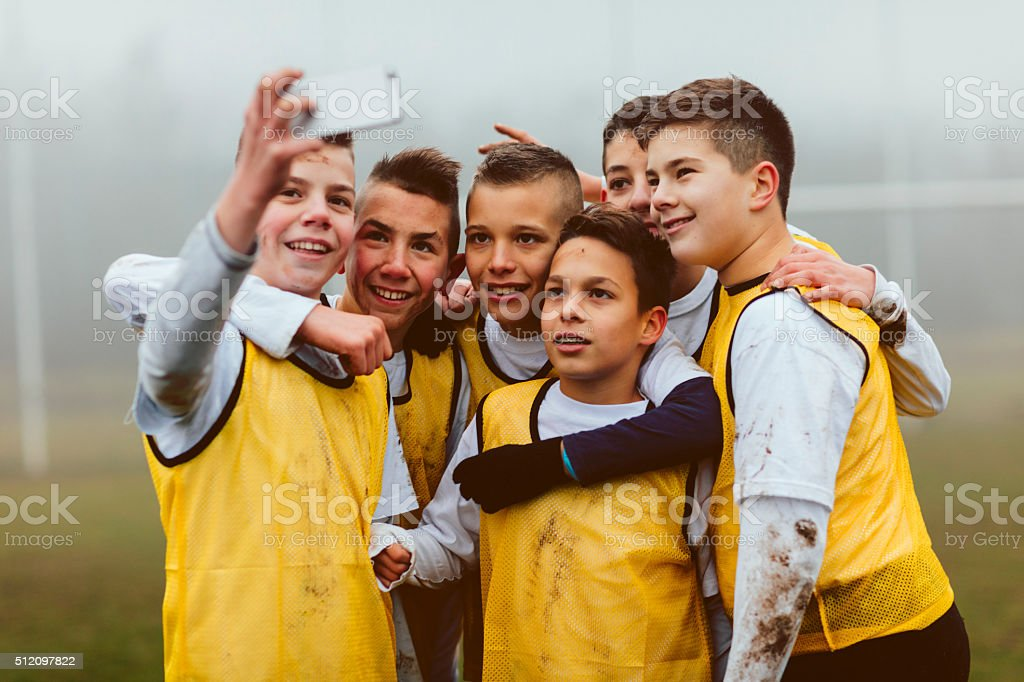 Kids Making Selfie After Playing Soccer. stock photo