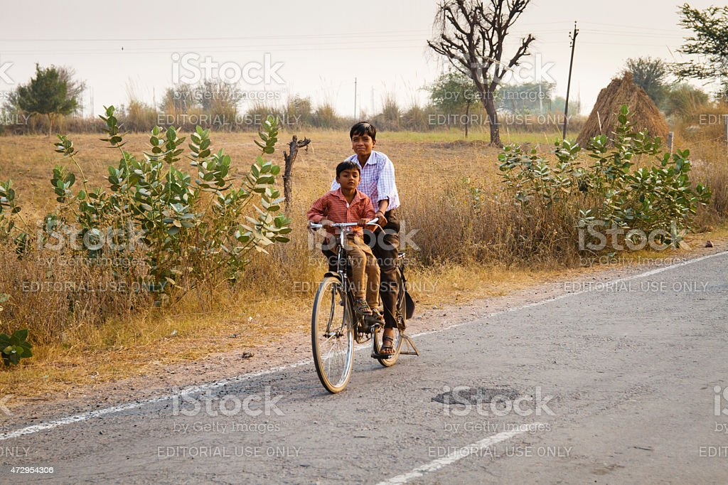 Kids on bike stock photo