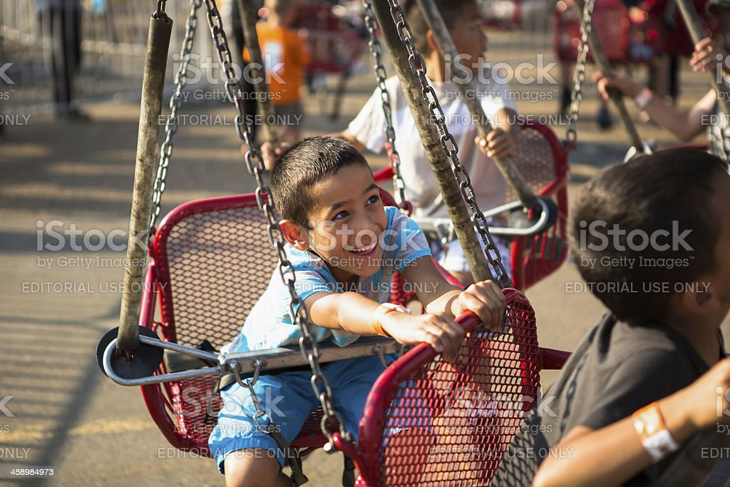 Kids on chain swing ride royalty-free stock photo