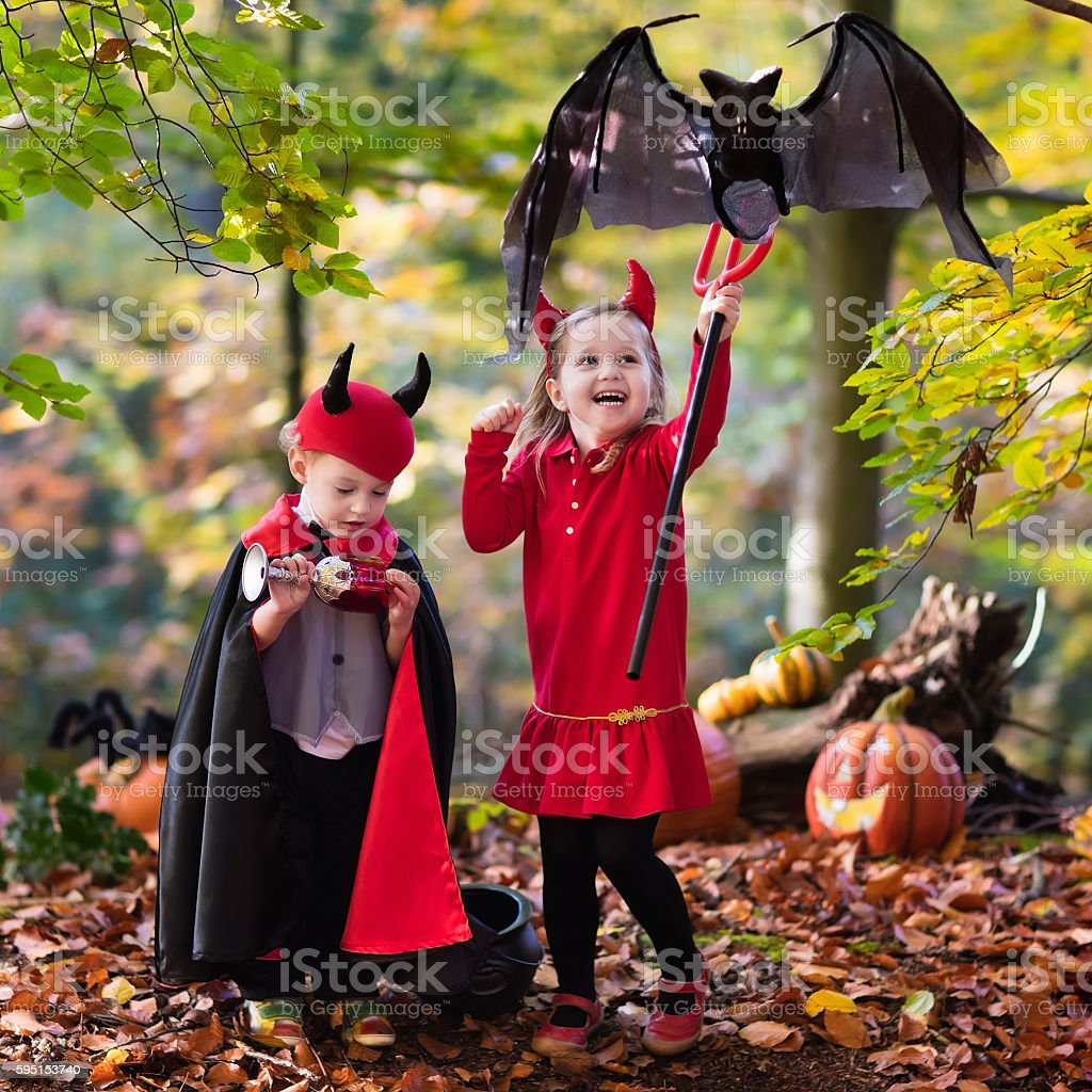 Kids on Halloween trick or treat stock photo
