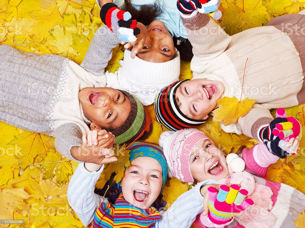 Kids on  leaves royalty-free stock photo